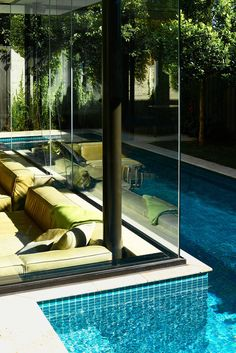 This house has a sunken living room so people can be at the same level as those in the swimming pool next to it
