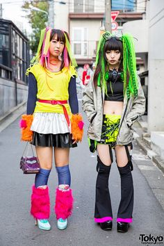 [Cyber Fashion] It's very hard to miss this Cyber Fashion on the street. Left: Mika, She is wearing layered tops with a ruffled handmade skirt and an Anna Sui car-shaped purse. She has pink and yellow hair falls in her twin tails, a plastic choker, faux-fur arm and leg warmers. The girl with green hair falls, gas mask, and goggles. She's wearing a resale jacket over a crop top, a Pen & Lolly skirt and CyberDog suspender legwarmers. She told us her accessories are handmade. #CyberStyle