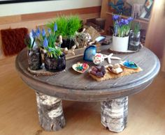 "A recycled table top & logs from Natural Pod ("",)"