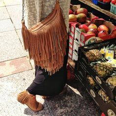 Spotted: Fringe booties and handbags are a total yes.