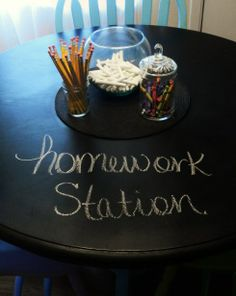 A chalkboard homework table. Instead of using scratch paper!