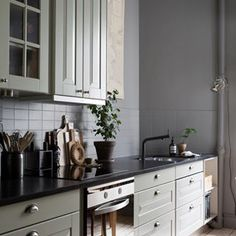 This elegant home is nestled in the Rösjöstaden (I dare you to try and pronounce that word!) district, here in Malmö, made up of beautiful . Grey Kitchen Designs, Interior Design Living Room, Luxury Kitchens, Home Kitchens, Gravity Home, Home And Deco, Elegant Homes, Beautiful, Home Decor