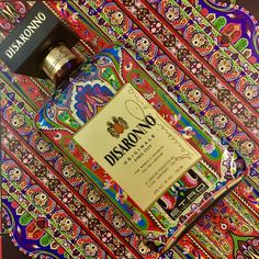 Etro has dressed @disaronno_official in a limited edition bottle design. The paisley-covered bottle comes alive with vibrant shades of blue orange and gold as envisioned by Etro. #DisaronnoWearsEtro #EtroCollaboration