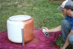 spray with heat and rust resistant paint - fire pit from washing machine innards