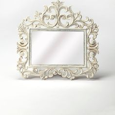 Accent your entryway or create a lovely focal point above the dresser with this elegant rectangular wall mirror, showcasing a floral scrollwork whitewashed wood frame with lily like details. material: MDF, Mirrored glass