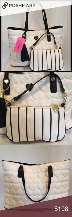 """☘️⬇️ Betsey Johnson Ivory Tote Bag & Wristlet NWT BETSEY JOHNSON 2 In 1 Ivory Tote Bag With Wristlet / Clutch New With Tags  MSRP: $108.00 Tote With Coordinating Detachable Wristlet / Clutch Exterior Ivory Quilted All Over Heart Print With Black Handles & Accents Fully Lined Logo Interior Features One Zip & 2 Slip Pockets Tote: 15"""" (L) x 11"""" (H) x 6.5"""" (D); Dual Handles With 9"""" Drop Wristlet: 9"""" (L) x 5.5"""" (H)  Great Gift Idea!  Smoke Free Home Betsey Johnson Bags Totes"""