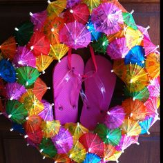 Umbrella and flip flop wreath I made for my daughters 3rd birthday party.