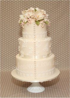 Vintage Garden Wedding Cake - with edible pearls, and floral lace details. Sugar flowers include Magnolias, hydrangea and filler flowers.  Love it!    ᘡղbᘠ