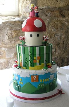 what a great Mario Bros cake - love the little snapping plants around top tier!