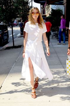 White tee, split skirt, brown leather platforms, reflective sunnies.