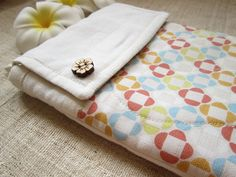 Retro geometric flowers - Padded iPad Linen Pouch. $34.99, via Etsy.