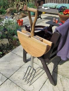 Folding table using wood scraps, old garden fork, and some hardware. No DIY here but it looks simple enough to create.
