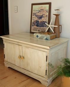 A cabinet distressed with paint and stain so as to be rustic and vintage-like.