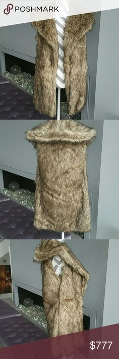 "Goregous Faux fur vest NWT Brand new with tags   This goregous long faux fur vest features lovely faux fur, oversized collar, pockets on side and is fully lined. Perfect to pair with a sweater, jeans/leggings and your favorite boots or pair over your favorite sweater dress! A season MUST HAVE!!  Size medium  Length: 32"" Bust: 22"" across Material: shell:70%acrylic 30%polyester  Lining is black and 100%polyester Jackets & Coats Vests"