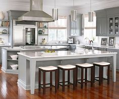 Grays work especially well in kitchens equipped with stainless-steel appliances and Carrara marble countertops. The surface material sports gray vein patterns, and the appliances are a shiny rendering of platinum gray. This kitchen puts different shades of gray -- the silvery tones of the appliances, fixtures, and faucet; the pearly gray island; the darker pewter upper cabinets -- into play to keep interest high while maintaining a breezy scheme./