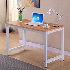 Yaheetech Simple Design Computer Table Wood Desktop Metal Frame Workstation Home Office Desk. Dimensions: 120×60×74cm (L×W×H) 47.2×23.6× 29 inch (L×W×H). Perfect for use in home, the study, office or at the corner and more. Could be used as a writing desk, workstation, computer/laptop desk etc. Sturdy metal frame coated in anti-rust and corrosion-free finish. Board Thickness: 1.5cm/0.6inch.