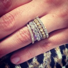 Love the look of stacked diamond rings!