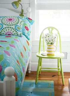 can't miss using a spare chair for an impromptu nightstand.  love the lime!