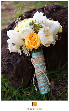 white & orange bouquet wrapped in teal #DBBridalStyle