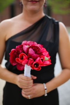 brides maid bouquet- love the variation in flowers & tones of red. I also love that it's not red roses (a bit more dynamic that way), also it's very spring time with the beautiful tulips & peonies.