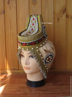 "Kichka or Kika, ancient Russian holiday headgear. Were mainly in the southern provinces (Tula, Ryazan, Kaluga, Orel et al.). For the first time, ""brow kichnoe"" mentioned in a document in 1328. Later became Kika attribute attire bride and married woman, as she, unlike a girl ""crown"" completely hides hair. In connection with this Kika was called ""crown of marriage.""Handmade."