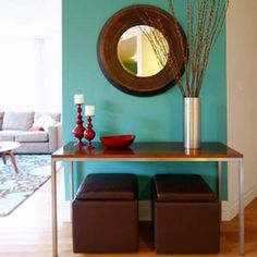 great colors ~ teal against dark brown & red ~ cool modern design and colorful living room / foyer