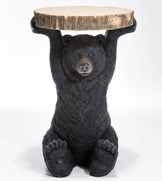 Quirky and unique.Our brown grizzly bear table will create a talking point in any room. Sitting large brown bear holds aloft a tree trunk slice to create this interesting side table. Perfect for the children's room, den or playroom - or simply indulge the big kid in you. A fun addition to any home.Polyresin58cm x 40cm x 39cm