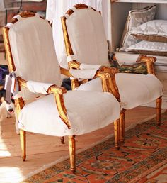 Chair slipcovers with buttoned tabs, straps to let the wood show. Pandora de Balthazar, Photos by Bruce Barone