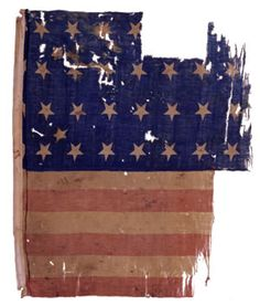 The New York State Battle Flag Collection includes one national flag attributed to the 11th Independent Battery, New York Volunteers. The printed, cotton and wool flag includes 29 stars in four rows and two offset insert stars. The cotton hoist edge obscures, in part, the first star in each row. Apparently the flag originally included 32 stars (4 rows of 8 stars) and someone later added the two insert stars.