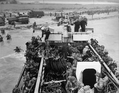 Canadian Troops Landing at Juno Beach June 1944 Photographer: Gilbert Milne Library and Archives Canada. I'm Canadian too, and looking at this picture makes me feel like there's a knot in my stomach. Canadian Soldiers, Canadian Army, Canadian History, D Day Normandy, Normandy Beach, D Day 1944, Royal Canadian Navy, Juno Beach, D Day Landings