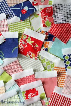 Don't you just love Moda's Candies?  Mini Charms by Bonnie & Camille,  Miss Kate. Moda Bake Shop: Scattered Squares Pillow free tutorial by Corey Yoder.