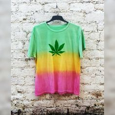 Pot leaf shirt in Rasta tie dye colours, tshirt is unisex & available in all sizes.  You always knew you were a bit of a one-off. Well now you can