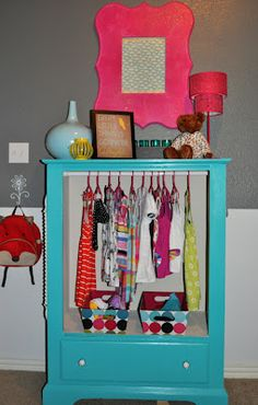 repurpose an old dresser into a wardrobe by removing the drawers.  cute for baby closet