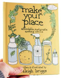 A cute. yellow book with illustrations of home-made, sustainable cleaning supplies, a wreath of leaves and a baby bottle