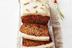 Cute carrot tops add a fun twist to this deliciously moist carrot, date and walnut loaf.