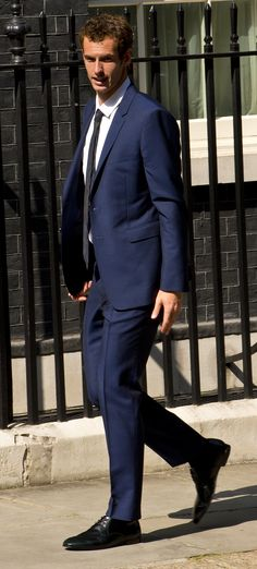 Wimbledon champion Andy Murray wearing Burberry tailoring to attend a reception at 10 Downing Street in London