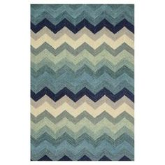 """Stylishly anchor your living room seating group or master suite ensemble with this artfully hand-hooked wool rug, showcasing an eye-catching chevron motif.   Product: RugConstruction Material: 100% WoolColor: Blue, cream and navyFeatures: Hand-hookedMade in India  Pile Height: 0.25""""   Note: Please be aware that actual colors may vary from those shown on your screen. Accent rugs may also not show the entire pattern that the corresponding area rugs have.  Cleaning and Care: Clean spills ..."""