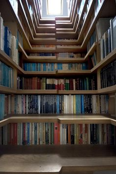 AT Europe: London Close-up - The Amazing Staircase, treads & shelves are completely lined with books.