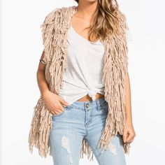 Shaggy Boho Chic Statement Vest Shag Style Vest Open Front  100% Acrylic Dry Clean only. Purchased from Urban outfitters Herald Square.  This is new and can fit all sizes. One size fits all. Urban Outfitters Jackets & Coats Vests