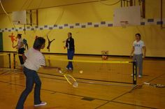 Duke Women's Tennis giving a few pointers to the kids in C.C. Spaulding's Playworks Durham after-school program