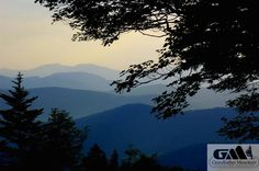 In this view from Grandfather Mountain in Linville, NC, the summer haze accents the rolling Appalachians in the distance.