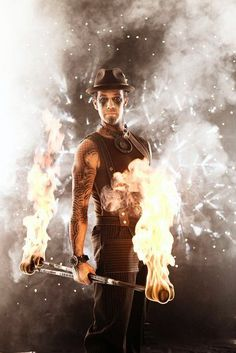Awesomely atmospheric photo of a Steampunk fire performer
