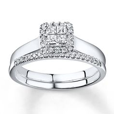 This bridal set for her features a stylish engagement ring with four princess-cut diamonds at its center framed in sparkling round diamonds. Additional round diamonds line up along the classic matching wedding band. The bridal set, styled in 10K white gold, has a total diamond weight of 1/2 carat. Diamond Total Carat Weight may range from .45 - .57 carats.