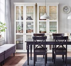 Ikea glass cabinets and black Ingolf chairs