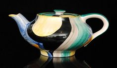 Susie Cooper - Grays Pottery - 8189 - A late 1920s teapot of compressed form decorated with an abstract pattern in black, blue, yellow and orange