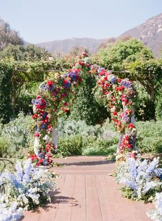 Gorgeous spring floral arch: http://www.stylemepretty.com/2015/03/10/colorful-summer-wedding-at-san-ysidro-ranch-part-one/ | Photography: Corbin Gurkin - http://corbingurkin.com/
