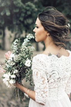 Lace wedding dress and messy up-do with small floral accesories | Image by Brittany Photographs #mountainwedding #coloradowedding s #wedding #bride #weddingceremony #weddingdress #bridalfashion #hair #lacedress
