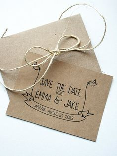 Vintage Save the Date cards on brown paper with cute calligraphy.