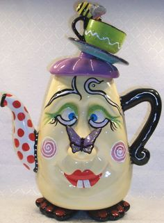 Whimsical and Fun!!!  There's so many tea pots to choose from.  Looks like I might have to start a collection soon. lol