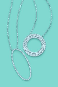 Tiffany Metro pendants in 18k white gold with diamonds, from left: oval and three- row circle. #TiffanyPinterest